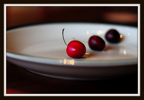 Three berries on a plate