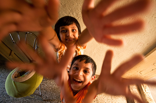 Two children jumping up towards the camera