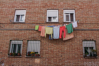 clothes hanging on a line outside a window